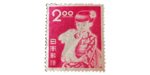 年賀切手少女と兎